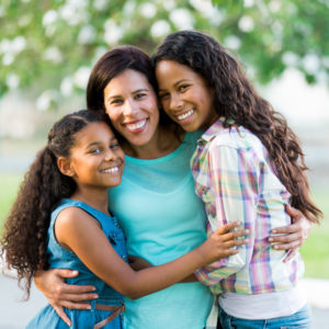 mom with her two daughters